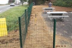 Pose de clôture de grillage rigide